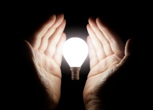 http://www.dreamstime.com/stock-images-hands-holding-light-bulb-bright-black-background-image32427614