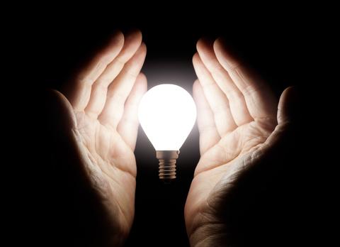 http://www.dreamstime.com/stock-images-hands-holding-light-bulb-bright-black-background-image32427614